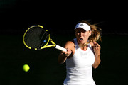 Caroline Wozniacki of Denmark plays a forehand in her Ladies' Singles second round match against Veronika Kudermetova of Russia during Day three of The Championships - Wimbledon 2019 at All England Lawn Tennis and Croquet Club on July 03, 2019 in London, England.