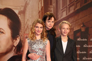 (L to R) Sophie Nelisse, Emily Watson and Nico Liersch arrive for the German premiere of the film 'The Book Thief' (Die Buecherdiebin) at Zoo Palast on January 23, 2014 in Berlin, Germany.
