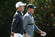 Brooks Koepka of United States talks with Justin Thomas of United States on the 14th hole during the second round of the CJ Cup at the Nine Bridges on October 19, 2018 in Jeju, South Korea.