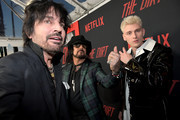 """Tommy Lee, Nikki Sixx and Machine Gun Kelly attend the premiere of Netflix's 'The Dirt"""" at the Arclight Hollywood on March 18, 2019 in Hollywood, California."""