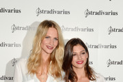 Poppy Delevigne (L) and Ursula Corbero (R) pose during a photocall for 'The Event Paper' party by Stradivarius on October 8, 2014 in Barcelona, Spain.