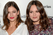Ursula Corbero (L) and Atlanta de Cadenet pose during a photocall for 'The Event Paper' party by Stradivarius on October 8, 2014 in Barcelona, Spain.