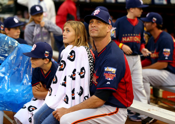 National League All-Star Tim Hudson #17 of the San Francisco Giants with his daughter during the Gillette Home Run Derby at Target Field on July 14, 2014 in Minneapolis, Minnesota. (July 13, 2014 - Source: Elsa/Getty Images North America)