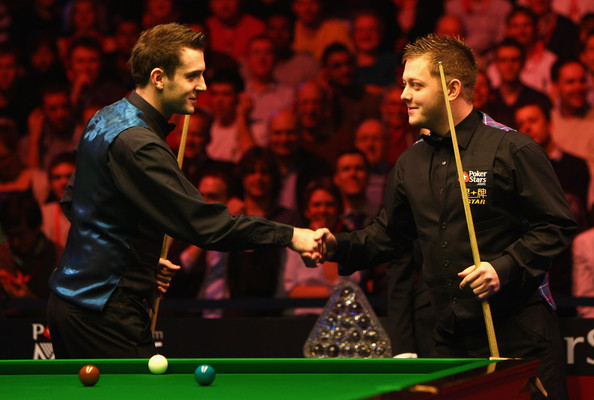 Mark Selby of England (L) shakes hands with Mark Allen of Ireland in their quarter final game during the PokerStars.com Masters tournament at Wembley Arena on January 15, 2010 in London, England.