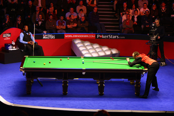 Mark Williams of England lines up a shot in his match against Rory McLeod during the PokerStar.com Masters snooker tournament at Wembley Arena on January 11, 2010 in London, England.