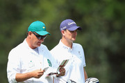 Justin Rose of England and his caddie Mark Fulcher during the final round of the 2014 Masters Tournament at Augusta National Golf Club on April 13, 2014 in Augusta, Georgia.
