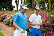 (L-R) Bubba Watson of the United States talks with Webb Simpson of the United States during a practice round prior to the start of the 2015 Masters Tournament at Augusta National Golf Club on April 6, 2015 in Augusta, Georgia.