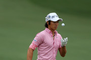 Ryo Ishikawa of Japan reacts after a shot during a practice round prior to the start of the 2012 Masters Tournament at Augusta National Golf Club on April 3, 2012 in Augusta, Georgia.