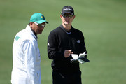 Justin Rose of England and his caddie Mark Fulcher look over a green during a practice round prior to the 2011 Masters Tournament at Augusta National Golf Club on April 5, 2011 in Augusta, Georgia.