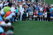 Patrons watch as Tiger Woods hits a shot during a practice round prior to the start of the 2012 Masters Tournament at Augusta National Golf Club on April 3, 2012 in Augusta, Georgia.