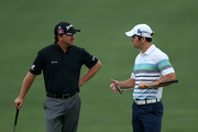 Graeme McDowell (L) of Northern Ireland talks with Paul Casey of England during a practice round prior to the start of the 2012 Masters Tournament at Augusta National Golf Club on April 3, 2012 in Augusta, Georgia.