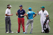 (L-R) Bubba Watson, Webb Simpson, Rickie Fowler and caddie Paul Tesori talk during a practice round prior to the start of the 2012 Masters Tournament at Augusta National Golf Club on April 3, 2012 in Augusta, Georgia.