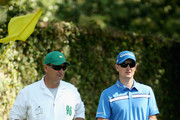 Justin Rose of England and his caddie Mark Fulcher stand on the second tee during the second round of the 2014 Masters Tournament at Augusta National Golf Club on April 11, 2014 in Augusta, Georgia.