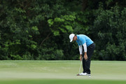 Rory McIlroy of Northern Ireland reacts to a missed putt on the fifth green during the third round of the 2018 Masters Tournament at Augusta National Golf Club on April 7, 2018 in Augusta, Georgia.