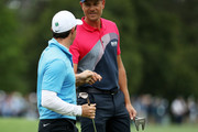 Rory McIlroy of Northern Ireland celebrates wit Henrik Stenson of Sweden after making eagle on the eighth hole during the third round of the 2018 Masters Tournament at Augusta National Golf Club on April 7, 2018 in Augusta, Georgia.