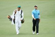 Rory McIlroy of Northern Ireland and caddie Harry Diamond walk up the second fairway during the third round of the 2018 Masters Tournament at Augusta National Golf Club on April 7, 2018 in Augusta, Georgia.