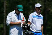 Justin Rose of England waits with his caddie Mark Fulcher on the fourth tee during the third round of the 2014 Masters Tournament at Augusta National Golf Club on April 12, 2014 in Augusta, Georgia.