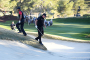 Phil Mickelson and Tiger Woods play from a bunker on the 14th hole during The Match: Tiger vs Phil at Shadow Creek Golf Course on November 23, 2018 in Las Vegas, Nevada.