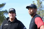 Tiger Woods and Phil Mickelson look on prior to The Match: Tiger vs Phil at Shadow Creek Golf Course on November 23, 2018 in Las Vegas, Nevada.