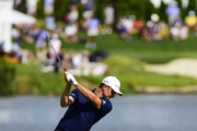 Justin Rose of England plays a shot on the 13th hole during the final round of The Northern Trust at Liberty National Golf Club on August 11, 2019 in Jersey City, New Jersey.