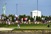 Justin Rose of England lines up a putt on the 13th green  during the final round of The Northern Trust at Liberty National Golf Club on August 11, 2019 in Jersey City, New Jersey.
