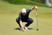 Justin Rose of England lines up a putt on the fifth green  during the final round of The Northern Trust at Liberty National Golf Club on August 11, 2019 in Jersey City, New Jersey.