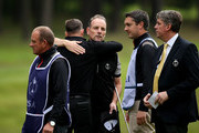 Christopher Currie of the Great Britain and Ireland PGA Cup team celebrates a point with partner David Higgins during the morning fourball matches on day 2 of the 28th PGA Cup at Foxhills Golf Course on September 16, 2017 in Ottershaw, England.