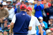 Jordan Spieth of the United States team is congratulated by his partner Dustin Johnson after he had holed a match winning par putt on the 18th hole in their match against Charl Schwartzel and Jason Day of the International Team during the Saturday morning foursomes matches at The Presidents Cup at Jack Nicklaus Golf Club Korea on October 10, 2015 in Songdo IBD, Incheon City, South Korea.