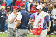 Dustin Johnson and Jordan Spieth of the United States Team celebrate a putt to win the match 1 up against Jason Day and Charl Schwartzel of the International Team during the Saturday foursomes matches at The Presidents Cup at Jack Nicklaus Golf Club Korea on October 10, 2015 in Songdo IBD, Incheon City, South Korea.