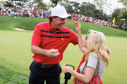 Phil Mickelson of the U.S. Team greets his wife Amy on the 17th hole after the team of Mickelson/Bradley defeated the Els/de Jonge team 2&1 during the Day Three Four-ball Matches at the Muirfield Village Golf Club on October 5, 2013  in Dublin, Ohio.