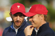 Jordan Spieth and Dustin Johnson of the United States Team wait on the second green during the Saturday foursomes matches at The Presidents Cup at Jack Nicklaus Golf Club Korea on October 10, 2015 in Songdo IBD, Incheon City, South Korea.