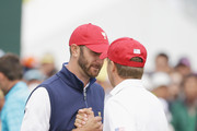 Dustin Johnson and Jordan Spieth of the United States Team celebrate on the 18th hole after defeating the team of Jason Day and Charl Schwartzel of the International Team 1up during the Saturday foursomes matches at The Presidents Cup at Jack Nicklaus Golf Club Korea on October 10, 2015 in Songdo IBD, Incheon City, South Korea.