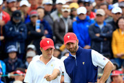 Jordan Spieth of the United States team line up a putt with his partner Dustin Johnson on the 18th hole in their match against Charl Schwartzel and Jason Day of the International Team during the Saturday morning foursomes matches at The Presidents Cup at Jack Nicklaus Golf Club Korea on October 10, 2015 in Songdo IBD, Incheon City, South Korea.