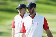 Dustin Johnson and Jordan Spieth of the United States Team wait on the fourth green during the Friday four-ball matches at The Presidents Cup at Jack Nicklaus Golf Club Korea on October 9, 2015 in Songdo IBD, Incheon City, South Korea