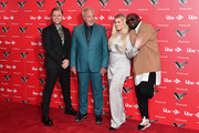 Olly Murs, Sir Tom Jones, Emma Willis, Meghan Trainor and Will.i.am attend The Voice UK 2019 photocall at The Soho Hotel on December 16, 2019 in London, England.