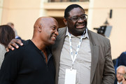 Writer/Director/Producer, John Singleton (L) and guest attend TheWrap's 8th Annual TheGrill at Montage Beverly Hills on October 2, 2017 in Beverly Hills, California.