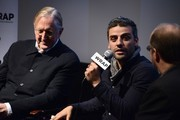 T-Bone Burnett, Oscar Isaac and Steve Pond attend a screening and Q & A of 'Inside Llewyn Davis' at the Landmark Theater on November 20, 2013 in Los Angeles, California.