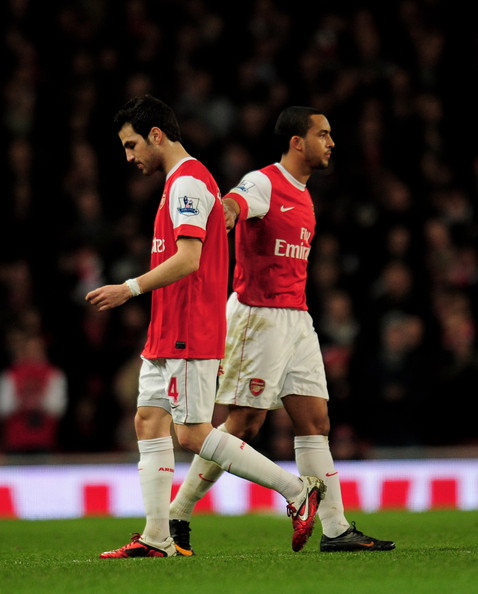 Theo Walcott Theo Walcott (R) of Arsenal pats teammate Cesc Fabregas as he is substituted during the Barclays Premier League match between Arsenal and Stoke City at the Emirates Stadium on February 23, 2011 in London, England.
