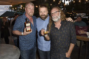 Actor Michael Cudlitz with creator of The Walking Dead and chairman of Skybound Entertainment Robert Kirkman and The Walking Dead's Greg Nicotero at the sneak preview event for Skybound's upcoming launch of The Walking Dead Kentucky Straight Bourbon Whiskey on July 19, 2019 in San Diego, California.