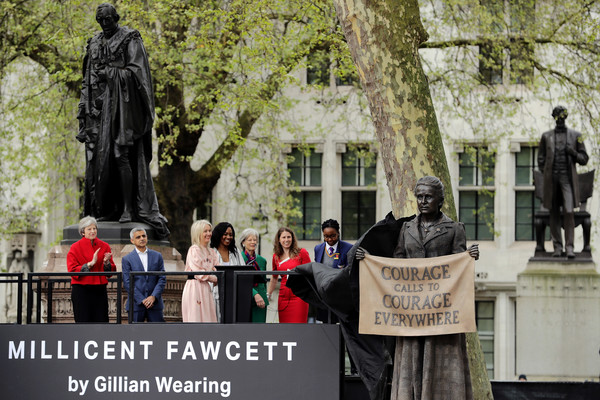 First Female Suffragette Millicent Fawcett Statue Unveiled In Parliament Square [tree,public event,statue,architecture,protest,event,adaptation,plant,crowd,monument,first female suffragette millicent fawcett statue,gillian wearing,theresa may,mayor,monument,statue,honour,parliament square,london,ceremony]
