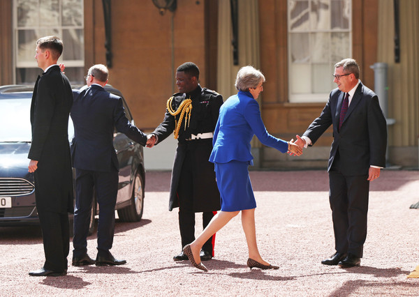 Queen Receives Outgoing And Incoming Prime Ministers [uniform,white-collar worker,official,event,gesture,suit,formal wear,tourism,bodyguard,businessperson,theresa may,queen,philip may,prime ministers,edward young,prime minister,monarch,number,palace,major]