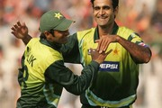 Shoaib Malik and Rao Iftikhar of Pakistan celebrate the wicket of Albie Morkel during the third One Day International match between Pakistan and South Africa held at Iqbal Stadium on October 23, 2007 in Faisalabad, Pakistan.