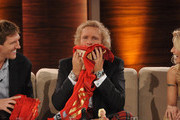 "Thomas Gottschalk (C) smells a shirt that Dirk Nowitzki (L) brought as present during the 199th ""Wetten dass...?"" show at the Rothaus Hall on December 3, 2011 in Friedrichshafen, Germany. After 24 years host Thomas Gottschalk terminates today his career as ""Wetten dass...?"" moderator."
