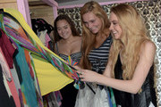 Allyson Ahlstrom (left) founder Threads for Teens and Season 4 winner of The Voice, Danielle Bradbery (right) helps a teen in the style studio at the Threads For Teens Mobile Boutique Tour at Hotel Indigo Nashville Downtown on July 21, 2014 in Nashville, Tennessee.