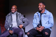 Adrian Peterson (L) and David Johnson speak onstage at The Thuzio Party During Super Bowl Weekend at SweetWater Brewery on February 1, 2019 in Atlanta, Georgia.