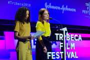 "Jurnee Smollett-Bell and Julianne Moore speak onstage at ""Time's Up"" during the 2018 Tribeca Film Festival at Spring Studios on April 28, 2018 in New York City."
