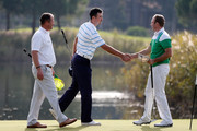 Niall Kearney (C) of Royal Dublin Golf Club is congratulated by Colm Moriarty (R) of Drive Golf Performance Limited during day three of the Titleist PGA Play-Offs at Antalya Golf Club on December 1, 2014 in Antalya, Turkey.