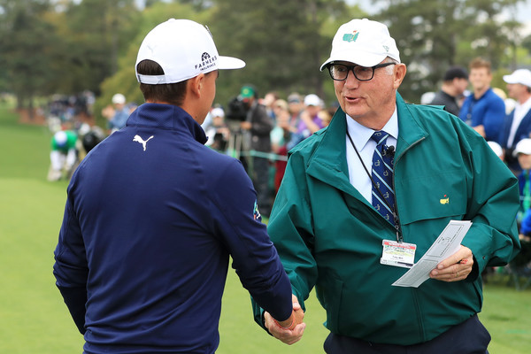 The Masters - Round Three [golf,fourball,recreation,competition event,championship,sport venue,golf course,coach,competition,games,tee,rickie fowler,starters,toby wilt,masters - round three,hands,united states,augusta national golf club,announcers committee,round]