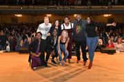 (L-R) Ashley C. Ford, Abby Wambach, Jennifer Rudolph Walsh, Naomi Ekperigin, Glennon Doyle, Amena Brown and Michael Trotter and Tanya Trotter of The War and Treaty pose on stage at Together Live at Taft Theatre on October 23, 2019 in Cincinnati, Ohio.