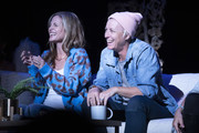 Glennon Doyle and Abby Wambach applaud on stage at Together Live at Walton Arts Center on October 18, 2019 in Fayetteville, Arkansas.